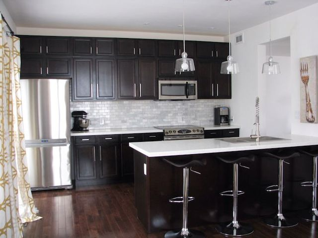 Black cabinets white countertops kitchen design ideas for White cabinets and countertops