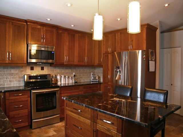 Titanium granite countertop dark cabinets backsplash ideas for Backsplash ideas with black cabinets