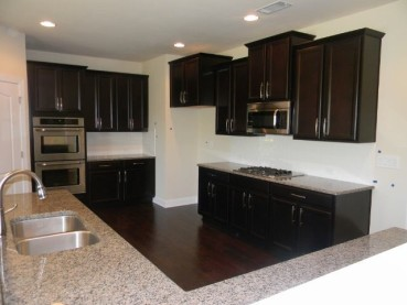 New Caledonia Countertops With Dark Cabinets Backsplash Ideas