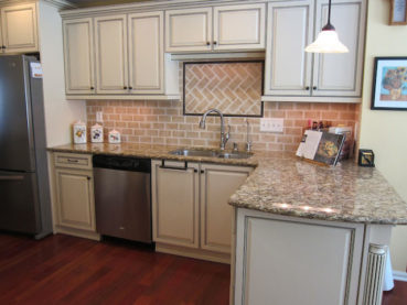 Whitewashed Brick Backsplash White Kitchen Cabinets